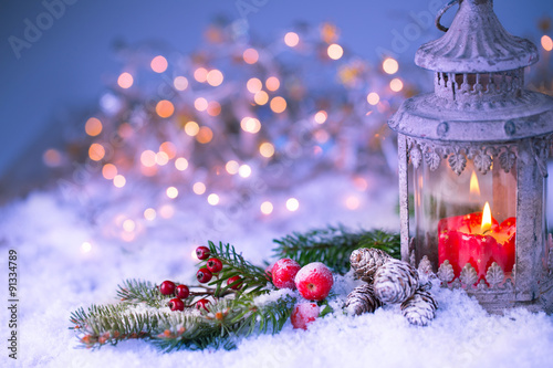 Christmas background - lantern with decorated  fir branch in cold snowy winter n Wallpaper Mural