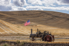 Steam Engine And Flag In Field.