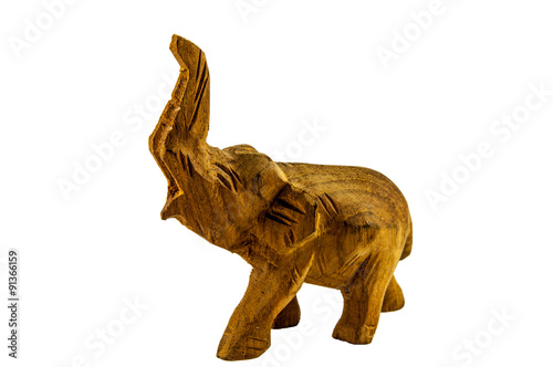 Elephant with a raised trunk carved out of wood