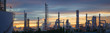 canvas print picture - Silhouette of petrochemical plant or Oil and gas refinery in sunrise