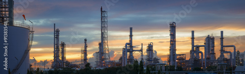 Fototapeta Silhouette of petrochemical plant or Oil and gas refinery in sunrise obraz