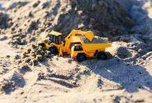 Sand Mining. Toy Truck And Excavator Mining Of Sand In A Quarry