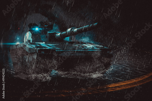 фотография  The modern battle tank moving at night in the rain on a mission