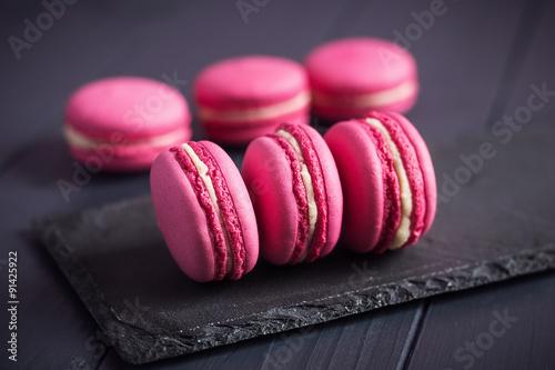 Aluminium Prints Macarons Pink raspberry macaroons on black background