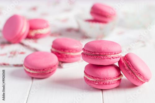 Poster Macarons Pink raspberry macaroons on white wooden background