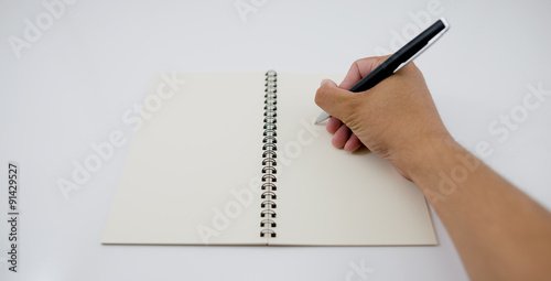 write something down on a notebook  - Buy this stock photo