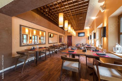 Fotobehang Restaurant Restaurant room with wooden furniture