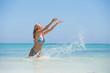 Cheerful woman having fun in the ocean