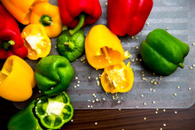 Colorful Bell Peppers On The Chopping Board