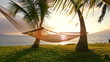 Hammock and Palm Trees at Sunset. Hammock Swinging on the Wind Between Two Palm Trees. Backyard Oceanfront Real Estate. Maui, Hawaii. Vacation Relaxation Lifestyle.