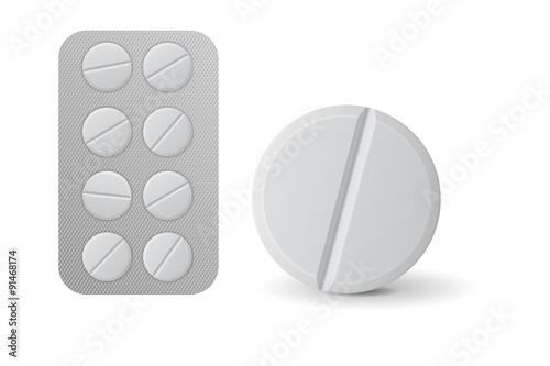Fotografia  Pills blister pack. White tablet.