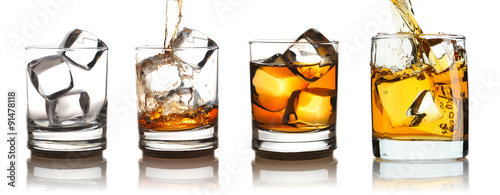 Whiskey in glass with ice set
