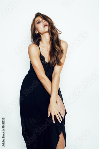 Young Brunette Pretty Woman In Black Dress Posing On White Buy