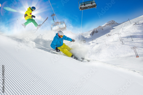 Garden Poster Winter sports Skier skiing downhill in high mountains