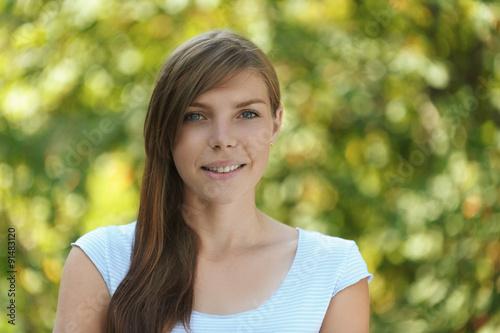 Fotografie, Obraz  smiling beautiful young woman close up