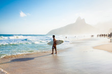Brazilian Surfer Walking With ...