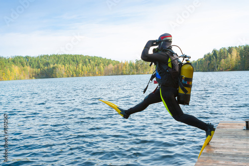 Poster Plongée The diver jumps into the forest lake