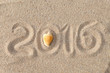 text 2016 in handwriting written in a sandy tropical beach