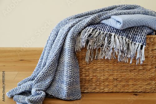 Photo  Cozy blankets in the basket