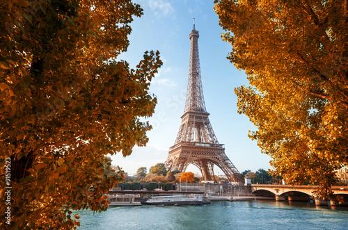 Poster Tour Eiffel Seine in Paris with Eiffel tower in autumn time