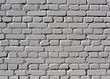 Gray color painted brick wall.