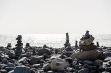 Art Of Stone Balance, Piles Of Stones On The Beach