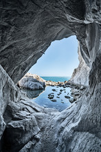 Sea Cave Rocks. Water Reflections