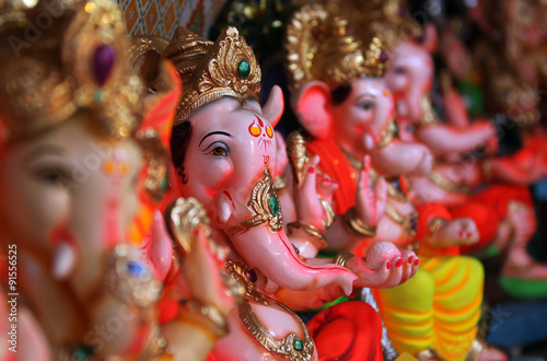 Photo  Beautiful idols of Lord Ganesha for sale in a Shop