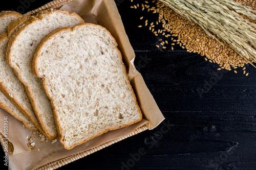 Fényképezés Whole Wheat Bread Background / Whole Wheat Bread / Whole Wheat Bread on Black Wo