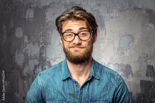 Fotografija  Bearded man with an expression of discontent on his face