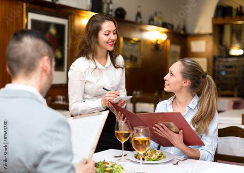 Cuadros en Lienzo Hospitable waitress taking order
