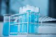 Laboratory glassware with liquid in blue tone
