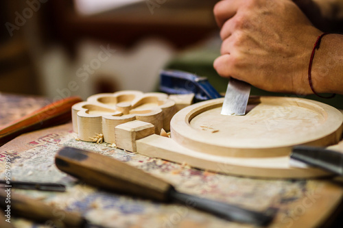 Valokuva  Carpenter hand carving wood with care