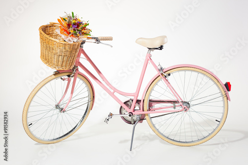 Aluminium Prints Bicycle pink vintage bicycle whith flower basket isolated on white backg