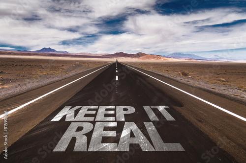 Fotografia  Keep it Real written on desert road