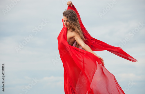 Deurstickers Akt nude woman with red fabric