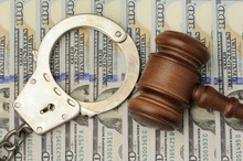 Gavel And Handcuffs On Dollars