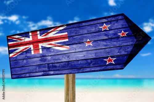 Foto op Canvas Australië New Zealand Flag wooden sign on beach background