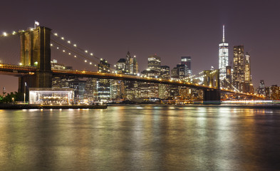 Fototapeta Brooklyn bridge and Manhattan at night, New York City, USA.