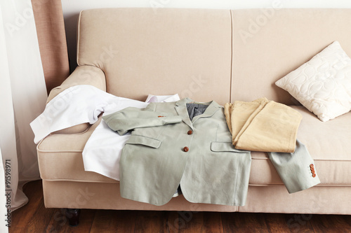 Papiers peints Retro Male clothing on sofa in room