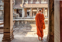 Buddhist Monk Exploring Courtyards Of Angkor Wat In Siem Reap