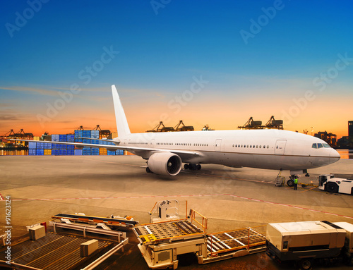 air freight and cargo plane loading trading goods in airport con Canvas Print