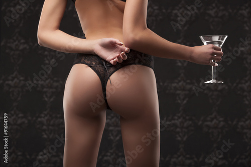 Fotografie, Obraz  Sexy woman in negligee holding glass, close-up