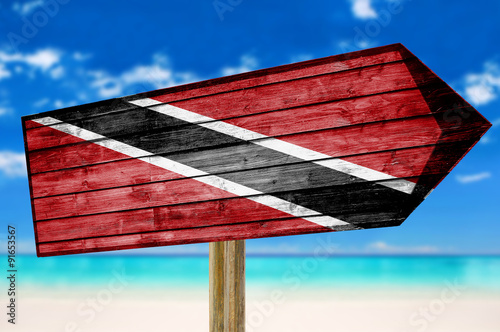 Foto op Canvas Australië Trinidad and Tobago Flag wooden sign on beach background