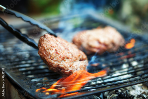 Spoed Foto op Canvas Grill / Barbecue Grilled Burgers