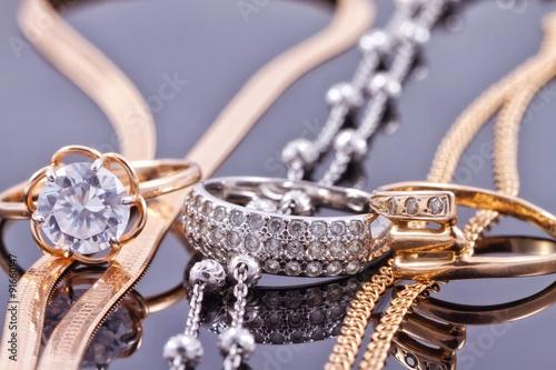fototapeta na szkło gold ring, earrings and chains