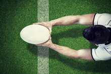 Composite Image Of High Angle View Of Man Holding Rugby Ball