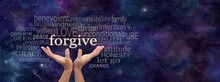 Forgiveness Is In Your Hands -  Female Open Palm Hands On A Wide Deep Space Blue Background Reaching Up To The Word Forgive Above Surrounded By A Word Cloud And Copy Space On Right Side