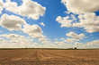 overlooking a mowed field and sky with clouds