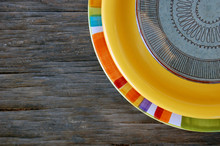 Colorful Plates On Wooden Back...